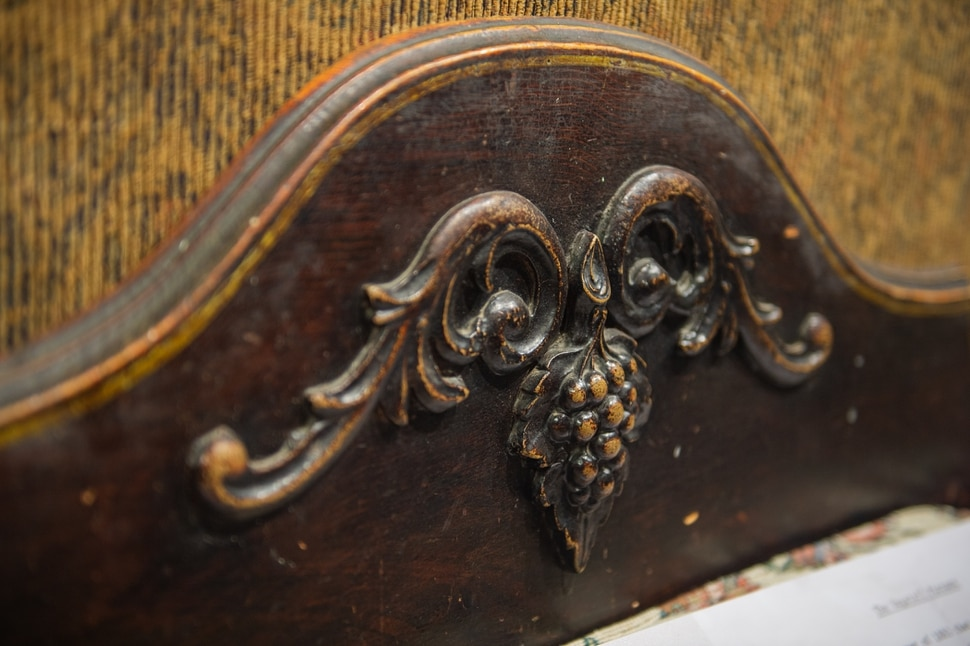(Rachel Molenda | The Salt Lake Tribune) A detail of a pioneer era bishop's couch at Anthony's Fine Art in Salt Lake City, on Thursday, July 19, 2018. The shop has a collection of early pioneer art and furniture on display.