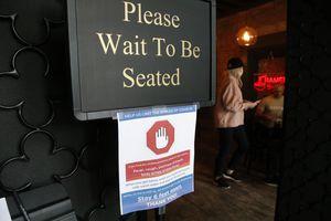 (Rick Bowmer | AP file photo) A social distancing guideline sign at Salt Lake City's Ramen Bar in May.