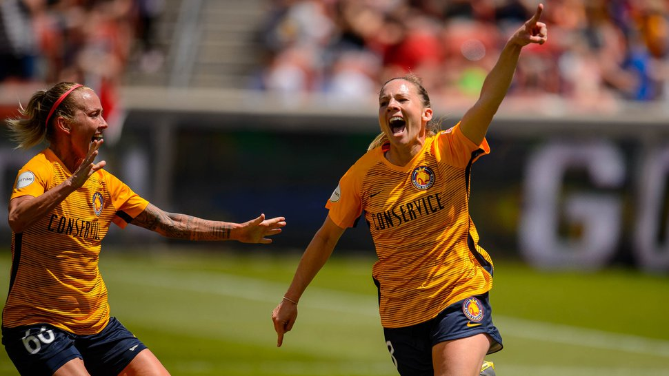 (Trent Nelson | The Salt Lake Tribune) Utah Royals FC forward Amy Rodriguez (8) celebrates her first half goal as Utah Royals FC hosts the Houston Dash at Rio Tinto Stadium in Sandy on Saturday May 11, 2019. At left is Gunnhildur Jonsdottir.