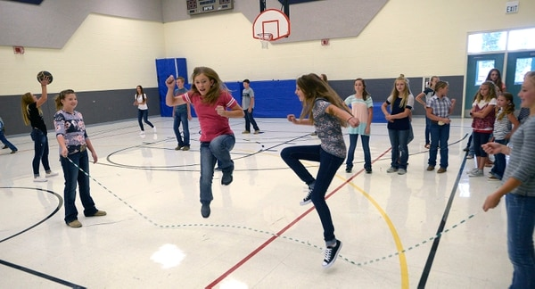 (Al Hartmann | The Salt Lake Tribune) Older girls do doubles jump roping at recess in the gym after lunch at Park Valley School, one of the smallest schools in Utah, teaching children between the ages of 5 and 15.
