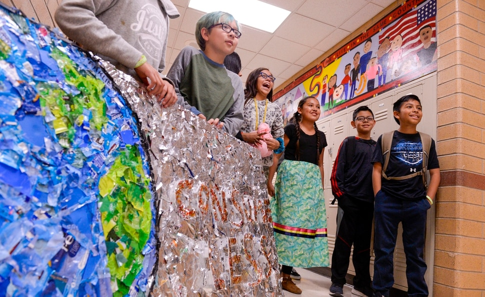 (Leah Hogsten | The Salt Lake Tribune) Students at Parkview Elementary have created a treasure with trash. Ten fifth graders in Cher Sten's extended learning program or ELP class, molded school and household plastic refuse into a mosaic to send the message: Consume Less to their classmates. The idea for the mural began after a discussion about global warming, climate issues, plastic pollution and its implications on earth.