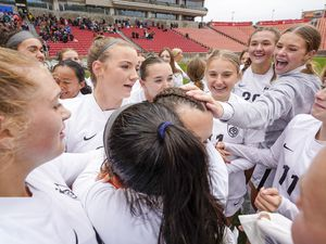 """(Leah Hogsten   The Salt Lake Tribune)  Ogden celebrates goalie Emily Blackford, crediting her with the win and shouting """"MVP."""" Ogden High School defeated Morgan High School, 1-0, to win the 3A State Soccer Championship game Oct. 23, 2021 at Rio Tinto Stadium."""