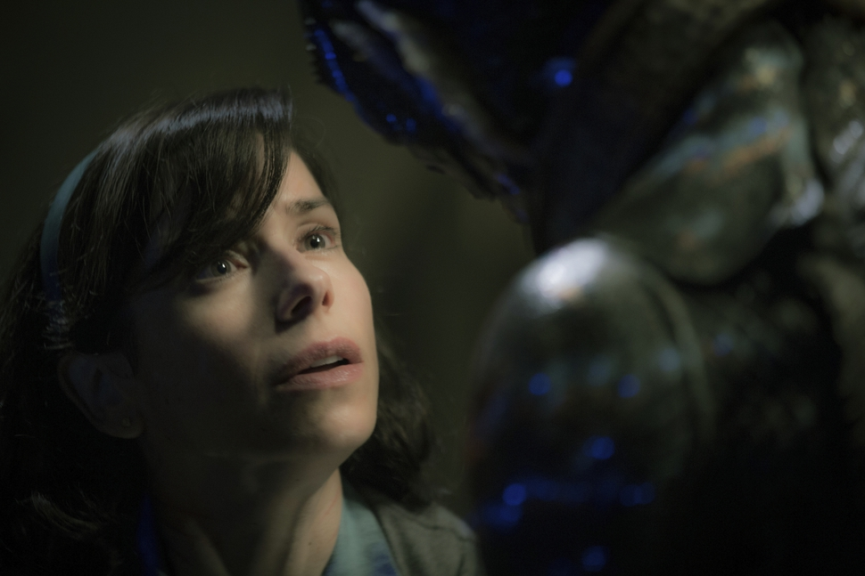 "File-This image released by Fox Searchlight Pictures shows Sally Hawkins, left, and Doug Jones in a scene from the film The Shape of Water. Ahead of Sunday's 90th Academy Awards, Associated Press film writers Lindsey Bahr and Jake Coyle share their predictions for a ceremony that, at least at the end, should be a nail biter. Best Picture, No controversy, timely messages, a dash of fantasy and a love of movies, ""The Shape of Water"" seems to be the safe, if a little boring, front runner. (Kerry Hayes/Fox Searchlight Pictures via AP, File)"