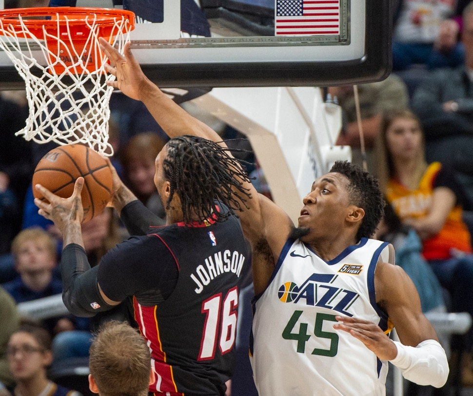 (Rick Egan | The Salt Lake Tribune) Utah Jazz guard Donovan Mitchell (45) stops Miami Heat forward James Johnson (16) from scoring, but is called for a foul on the play, in NBA action between Utah Jazz and Miami Heat, at Vivint Smart Home Arena Wednesday, Dec. 12, 2018.