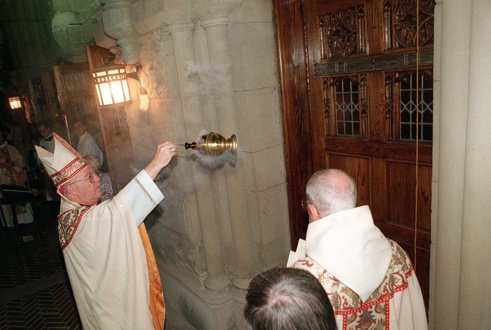Trent Nelson   The Salt Lake Tribune Bishop George H. Niederauer during the Blessing of Jubilee Doors at the Chrism Mass, Cathedral of the Madeline.