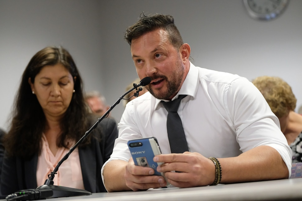 (Francisco Kjolseth | The Salt Lake Tribune) Justin Utley who considers himself a two year conversion therapy survivor speaks in support of a proposed ban on conversion therapy as he attends the public hearing before state regulators in Salt Lake City on Thursday, Sept. 26, 2019.