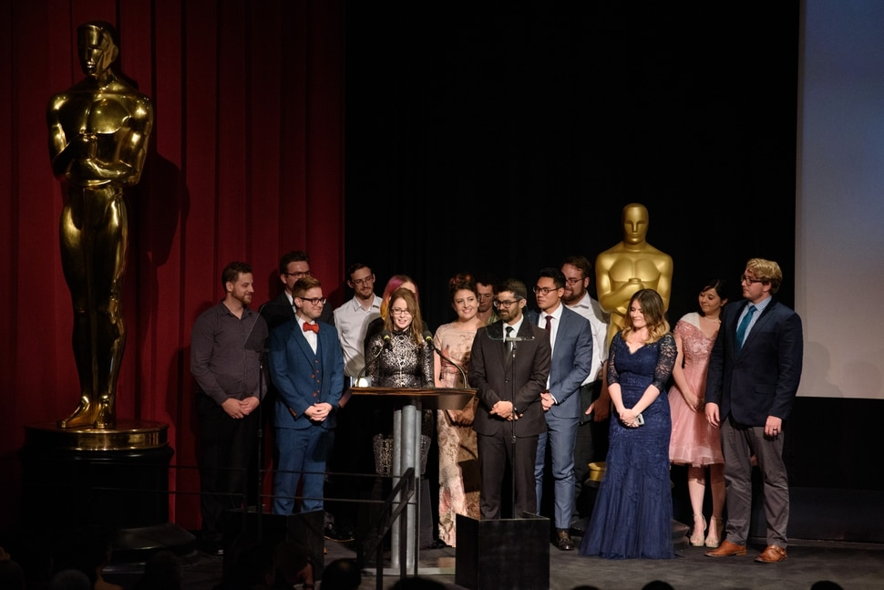 (Photo courtesy of Valerie Durant | AMPAS) Kalee McCollaum, director of the animated short film Grendel, calls up her Brigham Young University crew members as she accepts the Student Academy Award Gold Medal, in a ceremony in Beverly Hills, Calif, on Thursday, Oct. 17, 2019. The film was made by students at BYU's Center for Animation.