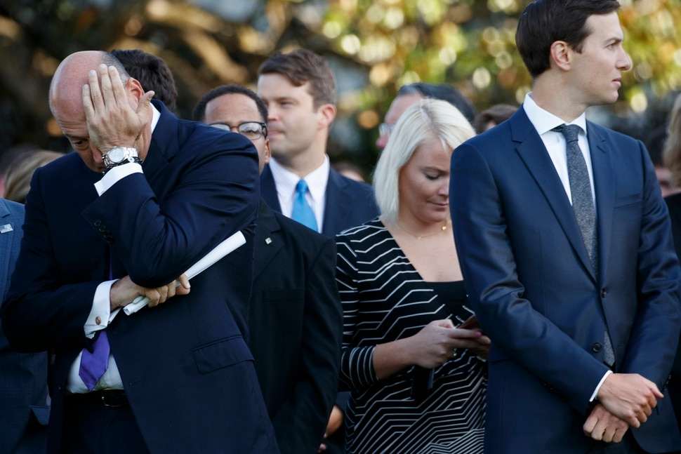 White House chief economic adviser Gary Cohn, left, and White House senior adviser Jared Kushner wait for the beginning of a ceremony to mark the anniversary of the Sept. 11 terrorist attacks, on the South Lawn of the White House, Monday, Sept. 11, 2017, in Washington. (AP Photo/Evan Vucci)