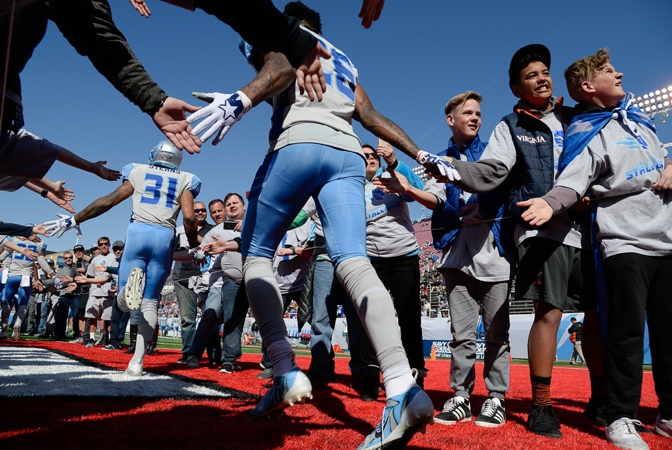 (Francisco Kjolseth | The Salt Lake Tribune) Fans line up to cheer on the Salt Lake Stallions as they take to the field for the second half as they host the Memphis Express of the Alliance of American Football in Salt Lake City on Saturday March 16, 2019.