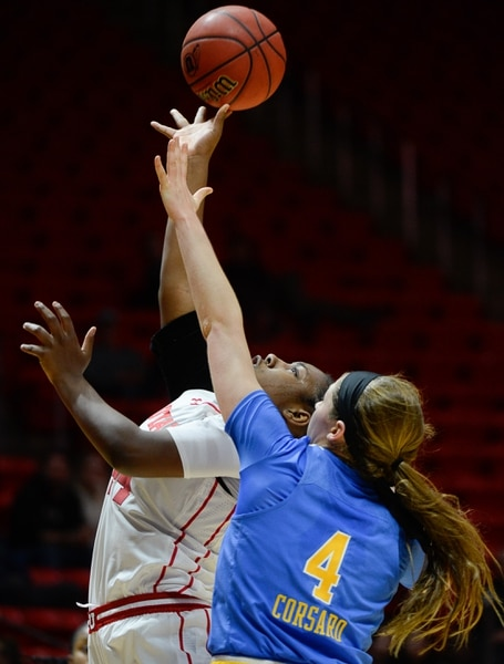 (Francisco Kjolseth | The Salt Lake Tribune) Utah Utes guard/forward Dre'Una Edwards (44) lays one up over UCLA Bruins guard Lindsey Corsaro (4) at the Jon M. Huntsman Center in Salt Lake City on Sunday, Feb. 10, 2019.
