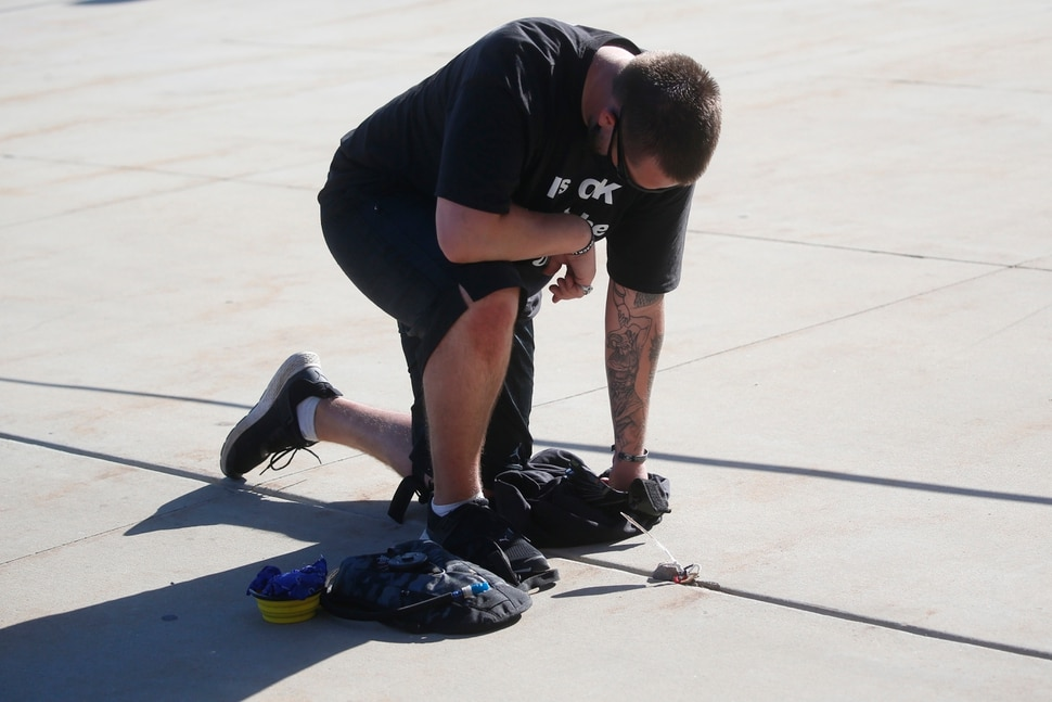 Shane Brooks, a Marine Corps veteran, kneels for nine hours outside the Utah Capitol to call attention to racial injustice, police brutality and mental health, Thursday, Aug. 6, 2020, in Salt Lake City. Brooks said people of color with mental illness are looked at as if they have already committed a crime and some end up dead in encounters with police, KTVX-TV reported. Brooks said his marathon silent protest was inspired by Bobby Duckworth, a 26-year-old who was shot and killed in 2019 by police responding to a report of a suicidal person in Wellington, Utah. (AP Photo/Rick Bowmer)