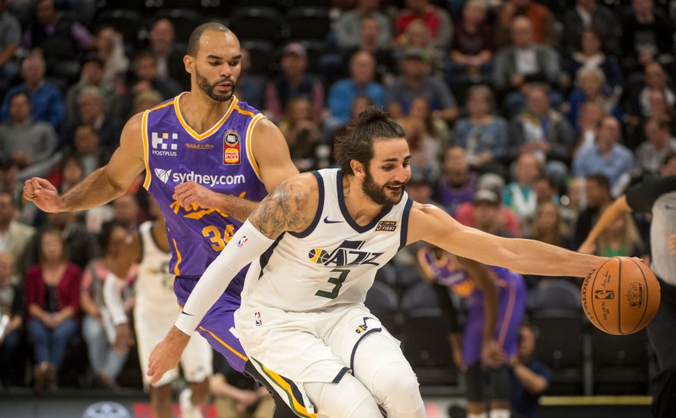 (Rick Egan | The Salt Lake Tribune) Utah Jazz guard Ricky Rubio (3) goes for a loose ball as Sydney Kings guard Perry Ellis (34) defends, in preseason basketball Utah Jazz vs.Sydney Kings, in Salt Lake City, Sunday, October 2, 2017.