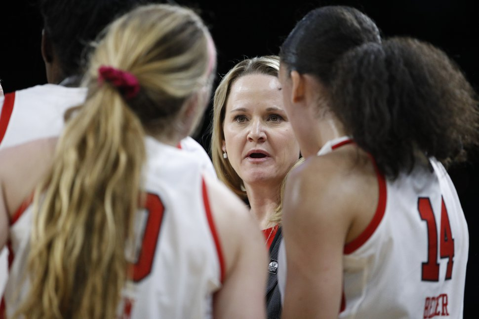 (AP Photo/John Locher) | Utah women's basketball coach Lynne Roberts says she is appreciative of the fact that her players are taking COVID-19 seriously and are keeping themselves safe outside the school's athletic facilities, where daily testing is now available.