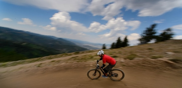 """Trent Nelson   The Salt Lake Tribune Mountain bikers on Deer Valley's Holy Roller trail, Saturday July 8, 2017. The three-mile trail, """"flows from the top of Bald Mountain to Silver Lake Village, providing riders an easy and fun option to descend the upper mountain."""""""