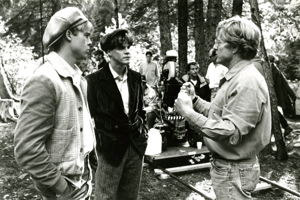 Director Robert Redford (r.) discusses a scene with Brad Pitt (l.) and Craig Sheffer in the drama