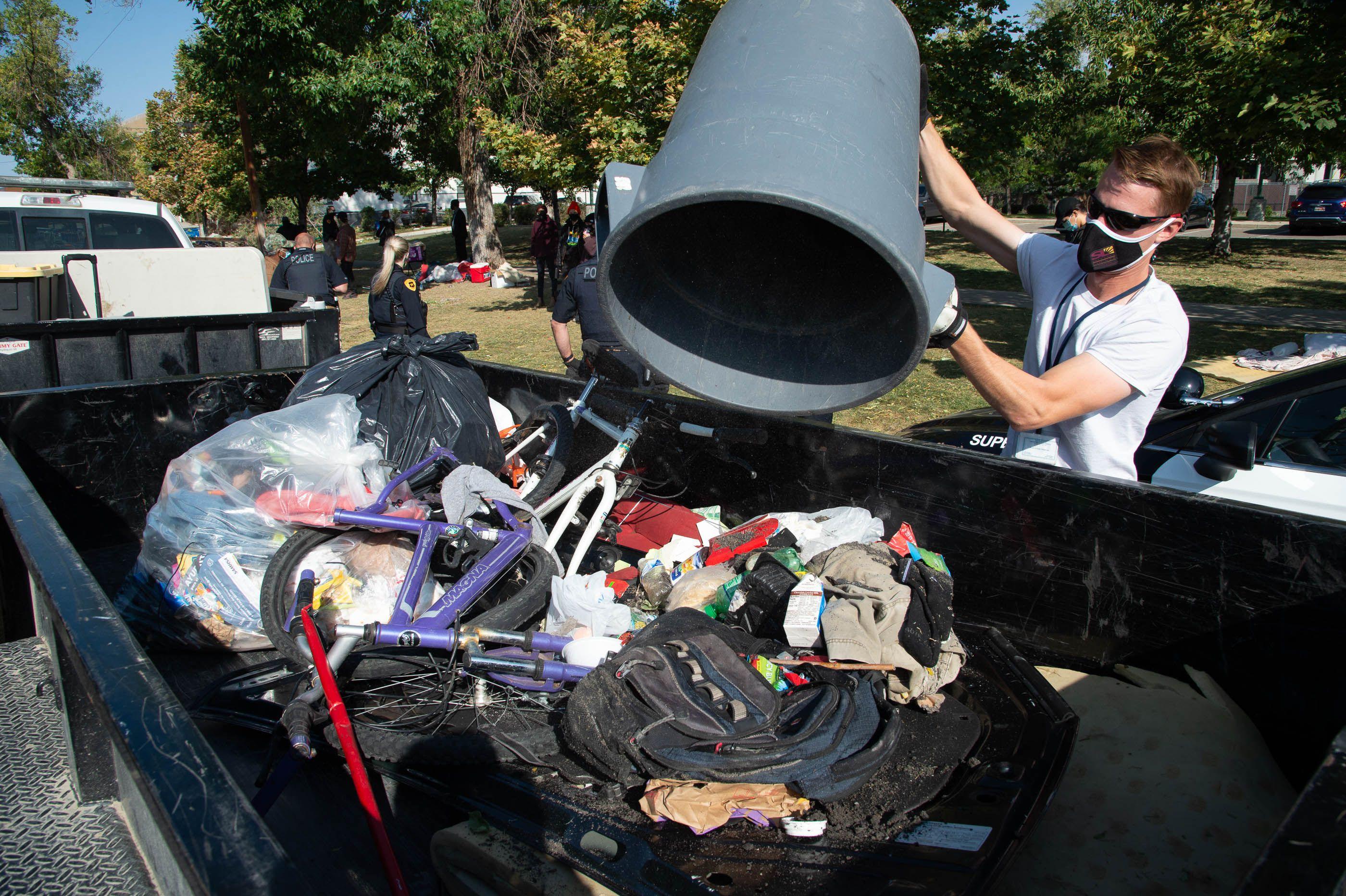 (Francisco Kjolseth  |  The Salt Lake Tribune) The Salt Lake County Health Department forces a clean up of homeless camps set up near Taufer Park in Salt Lake City on Thursday, Sept. 10, 2020.