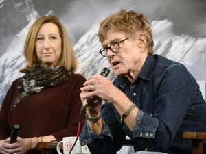 (Al Hartmann  |  Tribune file photo) Keri Putnam, left, executive director of the Sundance Institute, and the institute's founder, actor-filmmaker Robert Redford. Putnam announced on March 24, 2020, that the institute would cancel or postpone all live events through August 2020, and move many of them online, because of the coronavirus pandemic.