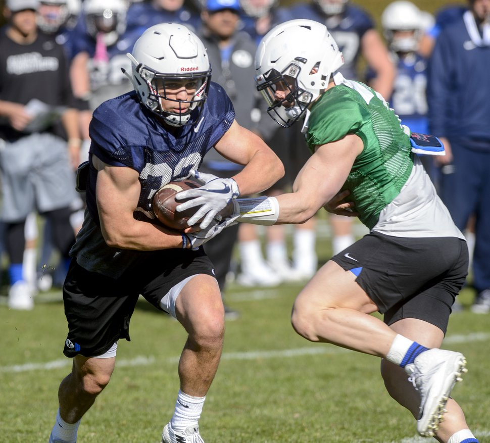 (Steve Griffin | The Salt Lake Tribune) BYU running back Zachary Katoa takes a handoff during spring football practice in Provo Monday March 12, 2018.