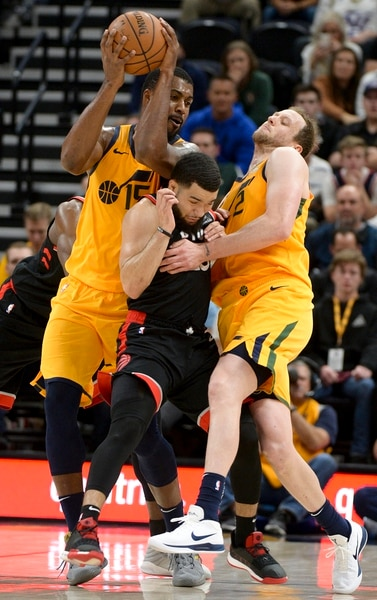 Leah Hogsten | The Salt Lake Tribune Toronto Raptors guard Fred VanVleet (23) is sandwiched between Utah Jazz forward Joe Ingles (2) and Utah Jazz forward Derrick Favors (15) as the Utah Jazz lose to the Toronto Raptors, 111-124, Monday, Nov. 5, 2018 at Vivint Smart Home Arena.