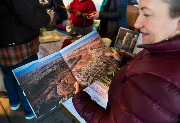 (Scott Sommerdorf | The Salt Lake Tribune) Blake Spalding, co-owner of Hell's Backbone Grill in Boulder, shows a photo from the new cookbook,