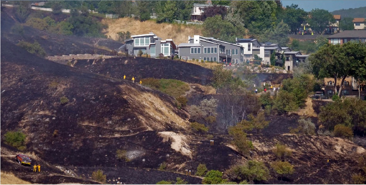 Grass fire near Salt Lake City's Ensign Peak damages one home. Three firefighters and two residents were injured.