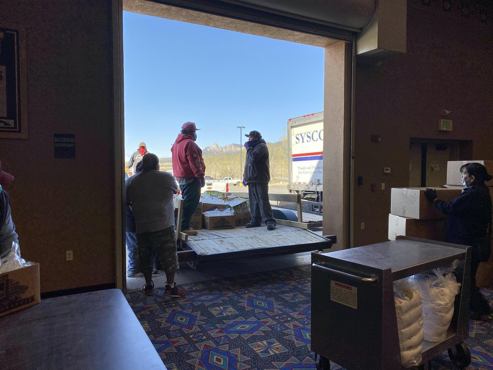 (Photo courtesy of Ute Mountain Casino Hotel) Volunteers and employees of the Ute Mountain Casino Hotel in Towaoc, Colo., load food onto trailers to assist with coronavirus relief efforts on Ute Mountain Ute lands.