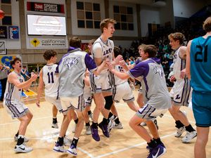 (Trent Nelson  |  The Salt Lake Tribune) Lehi players celebrate a win over Farmington High School in the 5A boys basketball state championship game, in Taylorsville on Saturday, March 6, 2021.