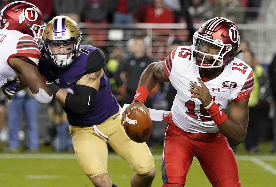 Utah quarterback Jason Shelley (15) rolls out against Washington during the first half of the Pac-12 Conference championship NCAA college football game in Santa Clara, Calif., Friday, Nov. 30, 2018. (AP Photo/Tony Avelar)