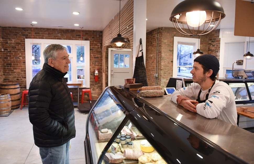 (Francisco Kjolseth | The Salt Lake Tribune) Store regular Dave Nimkin chats with Salt Lake City's Beltex Meats owner Phillip Grubisa during a recent visit to the butcher shop near Liberty Park.
