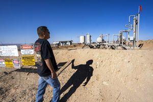 (Rick Egan   The Salt Lake Tribune) Parnell Thomas checks on some gas lines near his home north of Montezuma Creek, on Friday, Sept. 17, 2021.