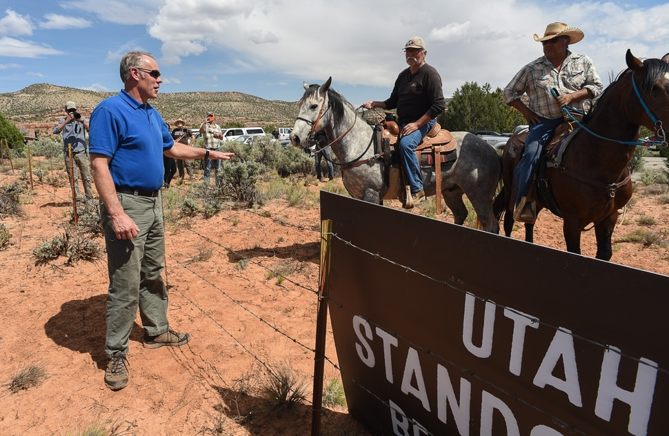 Francisco Kjolseth | The Salt Lake Tribune Interior Secretary Ryan Zinke speaks with Willy Grayeyes, center, and Leroy Teeasyaton of Utah Dine Bikeyah following a short hike to Butler Wash Indian Ruins by the secretary and members of the Utah delegation during a tour of the Bears Ears National Monument on Monday, May 8, 2017.