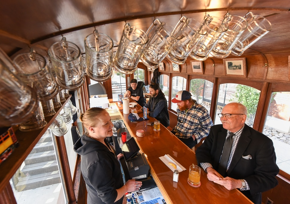 (Francisco Kjolseth | The Salt Lake Tribune) Bob Delahunty, right, speaks with bartender Cindi Robinson at Salt Lake City's Trolley Wing Co., once again serving cold beer and chicken wings from its namesake streetcar at Trolley Square.