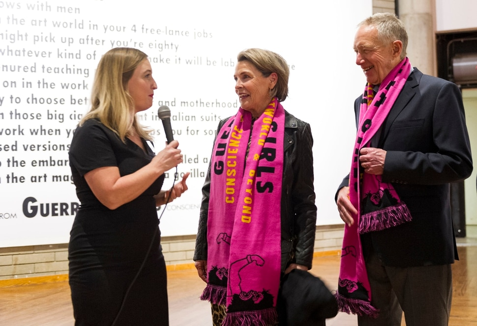 (Alex Gallivan | Special to The Tribune) Laura Hurtado, Director of the Utah Museum of Contemporary Art, speaks to Diane and Sam Stewart during the opening of the Guerrilla Girls exhibit and dedication of The Diane and Sam Stewart Main Gallery at the museum on Wednesday, Feb. 5, 2020.