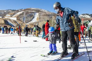 (Rick Egan   The Salt Lake Tribune) Zac Beveridge skis with 3-year-old Finley on opening day at Park City, on Friday, Nov. 20, 2020.