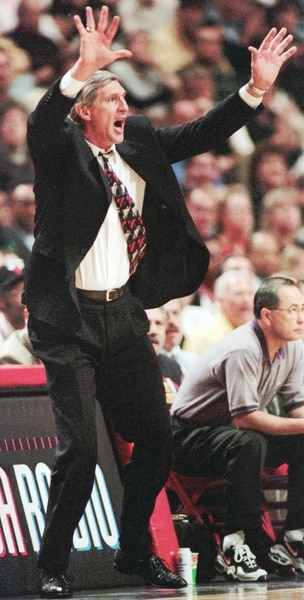 (Beth A. Keiser | AP Photo) Utah Jazz head coach Jerry Sloan tries to calm his team down in the third quarter of Game 1 of the NBA Finals against the Chicago Bulls Sunday, June 1, 1997, in Chicago. The Jazz lost to the Bulls 84-82.