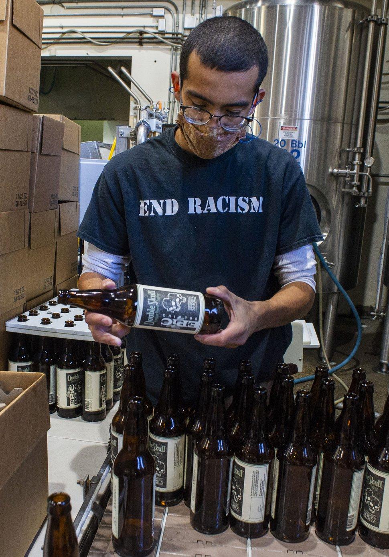 (Rick Egan | The Salt Lake Tribune) Jordan Vigil loads bottles in the brewery at Epic Brewing Co. in Salt Lake City, Thursday, Oct. 29, 2020.