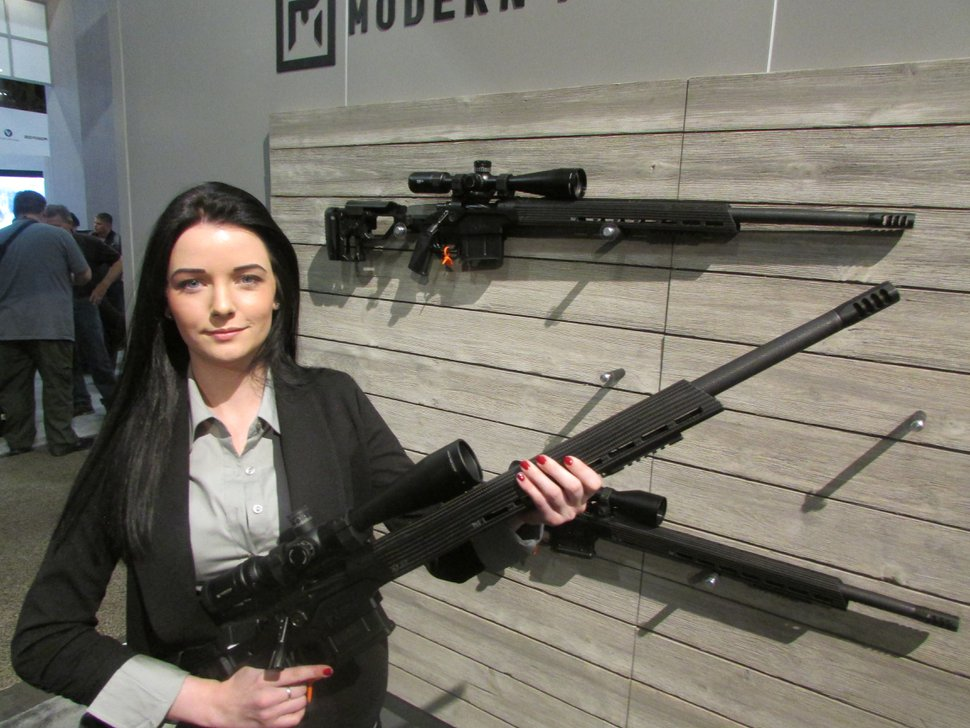 (Tom Wharton | Special to The Tribune) Taylor Whitney of Utah-based Christensen Arms holds the company's new Modern Precision Rifle at the SHOT Show in Las Vegas on Jan. 23, 2018.
