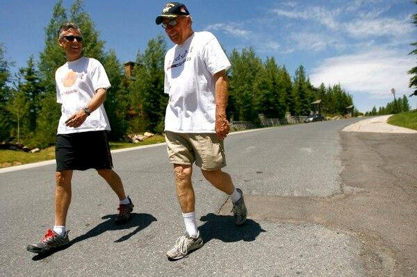 (Chris Detrick | Tribune file photo) Jon Huntsman Jr and Sr walk around Deer Valley Resort in June 2007.