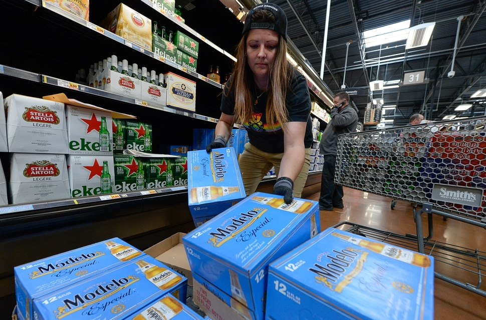 (Francisco Kjolseth | The Salt Lake Tribune) Ashlin Trolin of Kiitos Brewery in Salt Lake City joins other distribution crews as they fill the shelves at Smith's Food and Drug in Woods Cross with beer that is 5% alcohol by volume on Friday, Nov. 1, 2019, for the first time in 86 years.