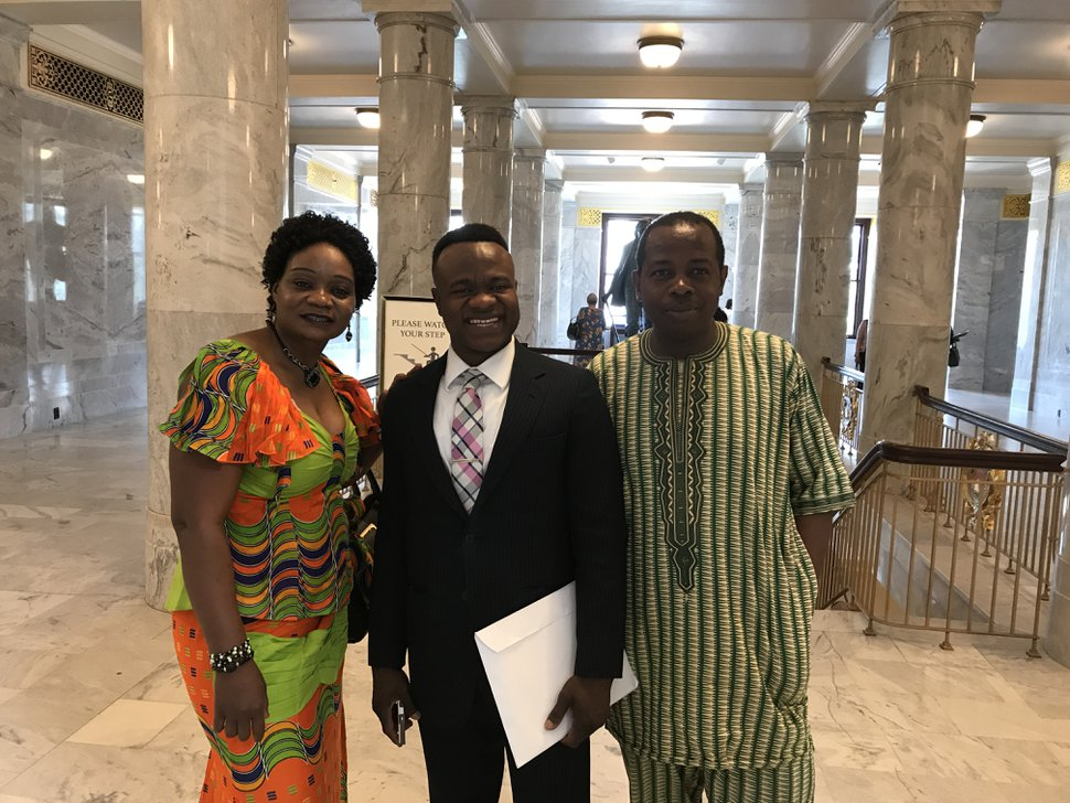 Benjamin Lamah (middle) became a naturalized U.S. citizen on Friday along with 109 others who were honored at the Utah State Capitol.