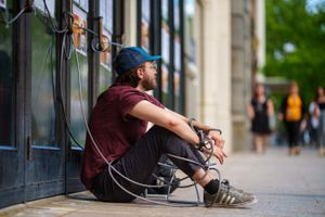 (Trent Nelson     The Salt Lake Tribune) Michael Valentine, chained to the Utah Theater in Salt Lake City on Tuesday, June 8, 2021, has now unhooked himself from the building and ended his hunger strike. But he is continuing his protest to try to save the playhouse from demolition.