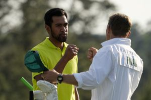 (David J. Phillip | AP) Tony Finau fist pumps his caddie Mark Urbanek after a birdie on the 18th green during the final round of the Masters golf tournament on Sunday, April 11, 2021, in Augusta, Ga.