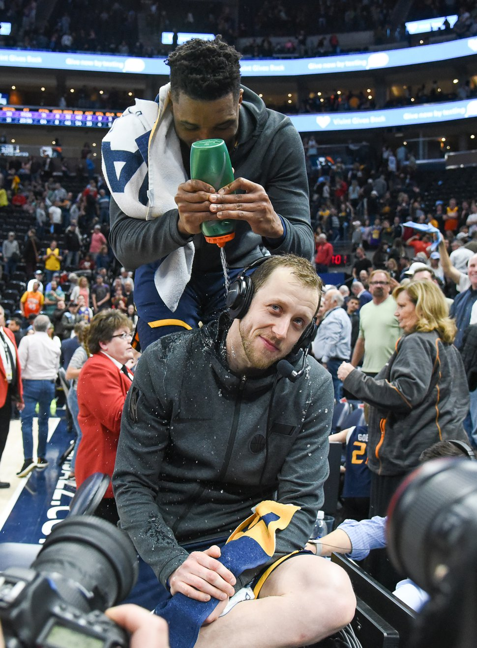 (Francisco Kjolseth | The Salt Lake Tribune) Utah Jazz guard Donovan Mitchell (45) sprays water on Utah Jazz forward Joe Ingles (2) as he does an interview to raise awareness for autism following their game against the Los Angeles Lakers in their NBA game at Vivint Smart Home Arena Wed., March 27, 2019, in Salt Lake City. Ingles son was diagnosed with autism and the Jazz have come out in support in a big way.