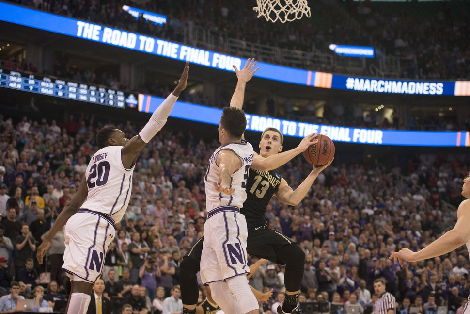 Trent Nelson | The Salt Lake Tribune Vanderbilt Commodores guard Riley LaChance (13) shoots under pressure from Northwestern Wildcats guard Bryant McIntosh (30) and Northwestern Wildcats guard Scottie Lindsey (20) during the first round of the NCAA Tournament in Salt Lake City on Thursday, March 16, 2017.