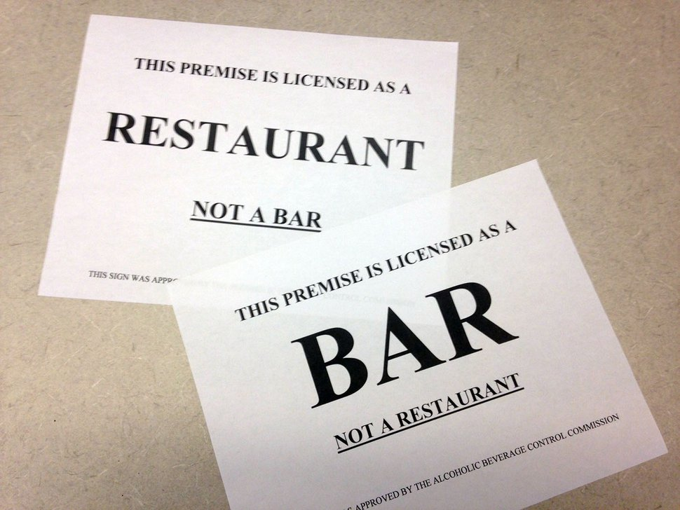 New signs like these are designed to help diners differentiate between bars and restaurants that serve alcohol.
