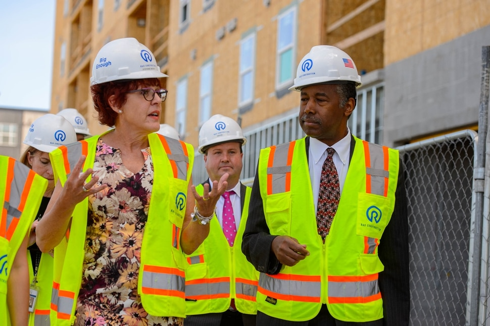 (Trent Nelson | The Salt Lake Tribune) Housing and Urban Development Secretary Ben Carson tours the HUB of Opportunity, a mixed-use real estate development located within an Opportunity Zone in Salt Lake City on Thursday July 11, 2019. The 200,00 square foot, HUD-supported facility is currently under construction. Giving Carson a tour of the site is Stephanie Mackay, at left. At rear is Troy Hart.