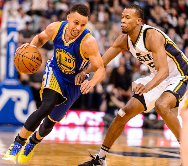 Trent Nelson | The Salt Lake Tribune Golden State Warriors guard Stephen Curry (30) drives on Utah Jazz guard Rodney Hood (5) as the Utah Jazz host the Golden State Warriors in Salt Lake City, Wednesday March 30, 2016.
