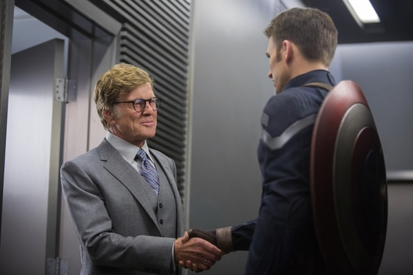 This image released by Marvel shows Robert Redford, left, and Chris Evans in a scene from