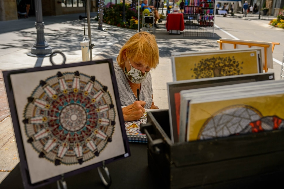 (Trent Nelson | The Salt Lake Tribune) Artist Lynette Nichols works in her booth at the Utah Arts Alliance's Art & Craft Market at The Gateway in Salt Lake City on Saturday, Aug. 1, 2020.