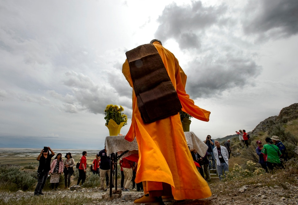 (Steve Griffin | The Salt Lake Tribune) Members of the Chinese Railroad Workers Descendants Association stand for a blessing of Chinese Arch following the reenactment of the completion of the Transcontinental Railroad at Promontory Summit in northern Utah Thursday May 10, 2018. Chinese Arch was created by natural forces and was a location for the camp of many of the Chinese railroad workers.